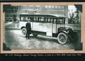 Mr. C.A. Stahlberg, Manual Training Tacher in front of the a 1920 GMC School Bus, 1923