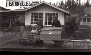Kids and their go-kart outside the Eatonville Lumber Co. (ca. 1920s)