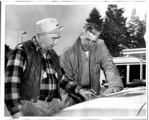 Sheriff Tim McCullough, right, examined a map of the Mount Rainier area with W. H. Smith, Eatonville town marshal, as a search continued for Joseph Self.