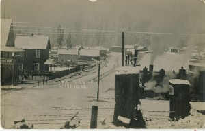 Train running through Eatonville, by the Depot Hotel around 1912