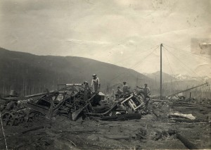 Japanese-American Millworkers standing on wreckage after the PNLC fire.
