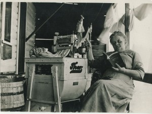 Mrs. Haynes washington with Eatonville's first washing machine