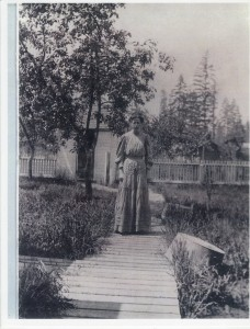 Nellie Van Eaton in the back yard