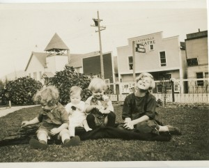 Kids in front of Theater and Methodist Church