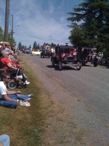 Old cars coming down Orchard during 2011 4th of July parade