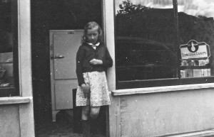Lois Daly Brown in front of the store (now Postnet)