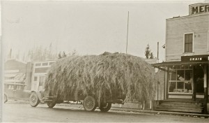 Truck full of hay outside the Red & White Store