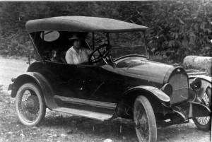Mrs. Norwood, School Secretary driving a Whippet car